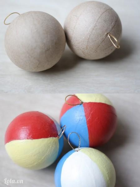 Sơn màu lên trên quả cầu giấy ( màu đỏ, vàng, xanh và trắng )