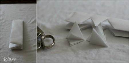 Gấp giấy làm đôi lặp lại 3 lần rồi cắt phần giữa giấy thành hình tam giác