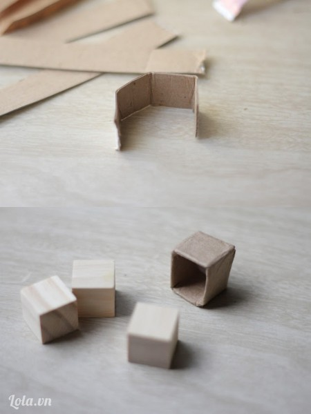 Xếp giấy bìa cứng thành một cái hộp nho nhỏ