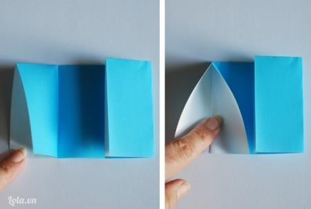 Mở bên giấy vừa gấp ra rồi cuốn phần đầu mép giấy lại tạo thành hình tam giác