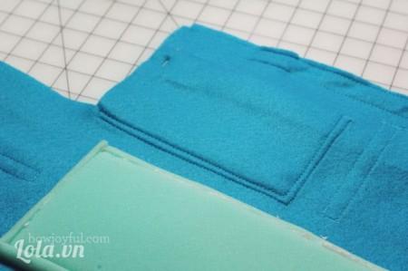 Sau khi may xong rồi thì bạn tiếp tục may các phần túi xung quanh như hình