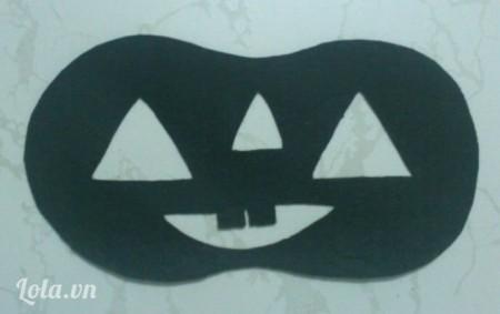 Cắt tấm vải nỉ màu đen như hình vẽ
