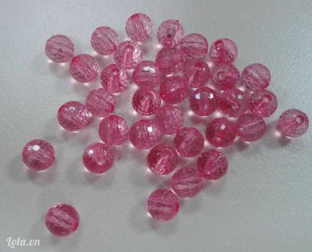 Hạt tròn có cạnh màu hồng trong suốt 6mm có  lỗ xỏ -10g