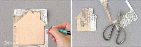 Bạn đặt mô hình ngôi nhà lên trên bề mặt giấy dán tường hoặc giấy màu,  bạn vẽ ra giấy rồi cắt nó ra