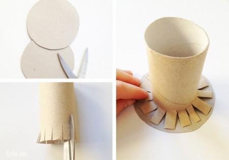Vẽ và cắt 2 hình tròn trên tấm bìa cứng có đường kính bằng với đường kính của miệng chậu. Đo chiều cao của lõi giấy bằng với chiều cao của chậu, phần lõi giấy thừa được cắt tua rua và dán lên hình tròn thứ nhất