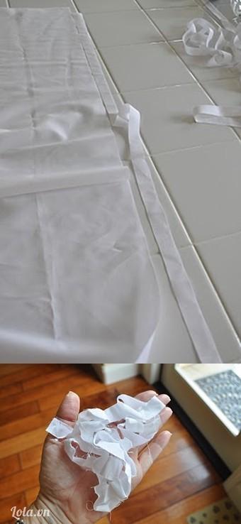 cắt vải trắng ra chiều dài tầm 1m