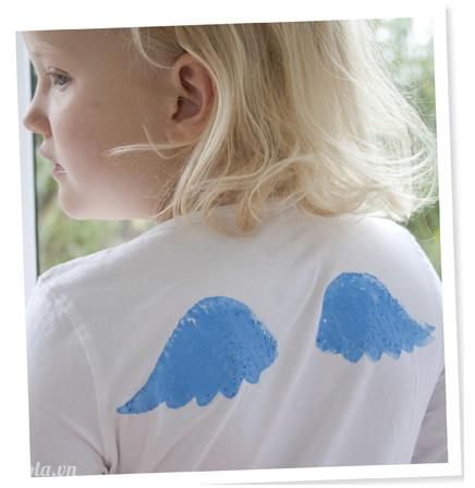 In hình cánh thiên thần lên áo trong tik tak