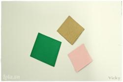 Cắt bìa giấy màu thành các mảnh hình thoi kích thước tùy ý để làm thân diều.