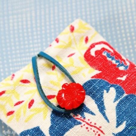 Đính thêm một nút lên trên mặt sau túi là hoàn thành xong sản phẩm