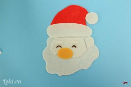 Dán nón vào mặt ông Noel
