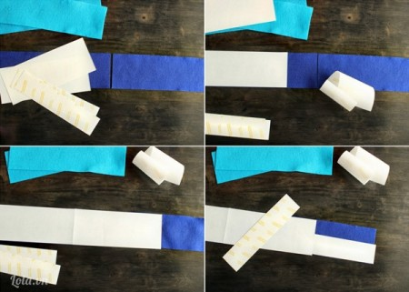 Bạn cần hai tấm vải nỉ khác màu, cắt chúng theo chiều dọc như hình và lần lượt dán chúng vào với nhau bằng băng dính hai mặt lên. Để đảm bảo được việc dán băng dính hai mặt không bị sai hướng, bạn cắt từng đoạn nhỏ và dán lần lượt như trong hình