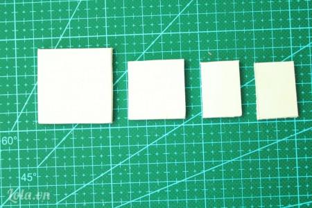 Cắt giấy mô hình thành 1 mảnh kích thước 3x3cm,  1 mảnh 3x4cm, 2 mảnh 2x3cm